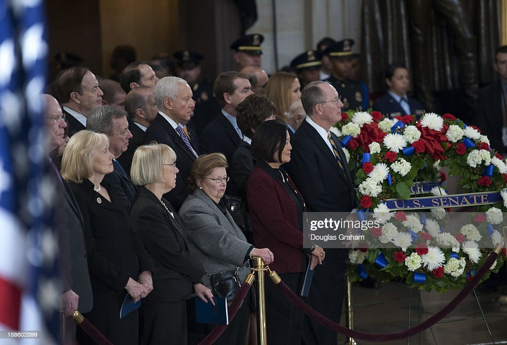 Members of the U.S. Senate watch as the flag is draped casket of U.S. Senator Daniel Inouye (D-HI) enters the Rotunda of the U.S. Capitol where he will lie in state December 20, 2012 on Capitol Hill in Washington, DC. The late Senator had died at the age of 88 on Monday at the Walter Reed National Military Medical Center in Bethesda, Maryland where he had been hospitalized since early December. A public funeral service will be held at the Washington National Cathedral on Friday for Senator Inouye, a World War II veteran and the second-longest serving senator in history. His remains will be returned and laid to rest in his home state.