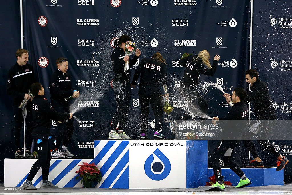 Members of the U.S. Short Track ladies team (l-r, center) <a gi-track='captionPersonalityLinkClicked' href=/galleries/search?phrase=Alyson+Dudek&family=editorial&specificpeople=5581264 ng-click='$event.stopPropagation()'>Alyson Dudek</a>, Jessica Smith and <a gi-track='captionPersonalityLinkClicked' href=/galleries/search?phrase=Emily+Scott+-+Speed+Skater&family=editorial&specificpeople=15291931 ng-click='$event.stopPropagation()'>Emily Scott</a> are sprayed with champagne by members of the men's team (l-r) Chris Creveling, <a gi-track='captionPersonalityLinkClicked' href=/galleries/search?phrase=J.R.+Celski&family=editorial&specificpeople=5581262 ng-click='$event.stopPropagation()'>J.R. Celski</a>, <a gi-track='captionPersonalityLinkClicked' href=/galleries/search?phrase=Jordan+Malone&family=editorial&specificpeople=2118197 ng-click='$event.stopPropagation()'>Jordan Malone</a>, Eduardo Alvarez and Kyle Carr on the medals podium during the U.S. Olympic Short Track Trials at the Utah Olympic Oval on January 5, 2014 in Salt Lake City, Utah.