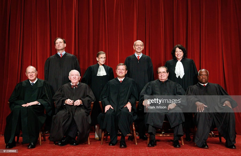 Members of the US Supreme Court pose for a group photograph at the Supreme Court building on September 29 2009 in Washington DC Front row Associate...