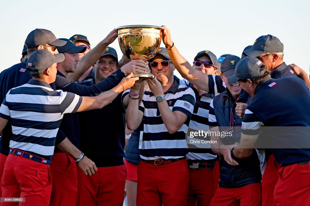Members of the U.S. Team celebrate with the trophy after they defeated the International Team 19 to 11 in the Presidents Cup at Liberty National Golf Club on October 1, 2017, in Jersey City, New Jersey.