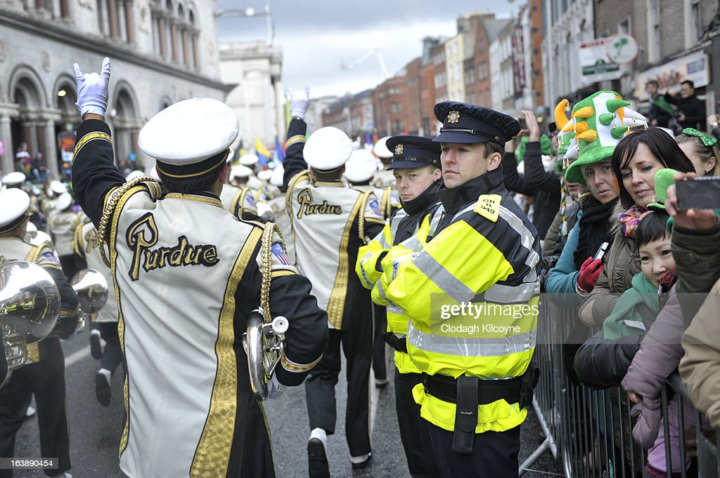 Members of the US University Purdue take part in the St Patrick's Day parade on March 17, 2013 in Dublin, Ireland. More than 100 parades are being held across Ireland to mark St Patrick's Day, the feast day of the patron saint of Ireland, with up to 650,000 spectators expected to attend the parade in Dublin. Ireland has high hopes that the festivities will bring a much-needed boost to the economy.er caption here on March 17, 2013 in Dublin, Ireland.