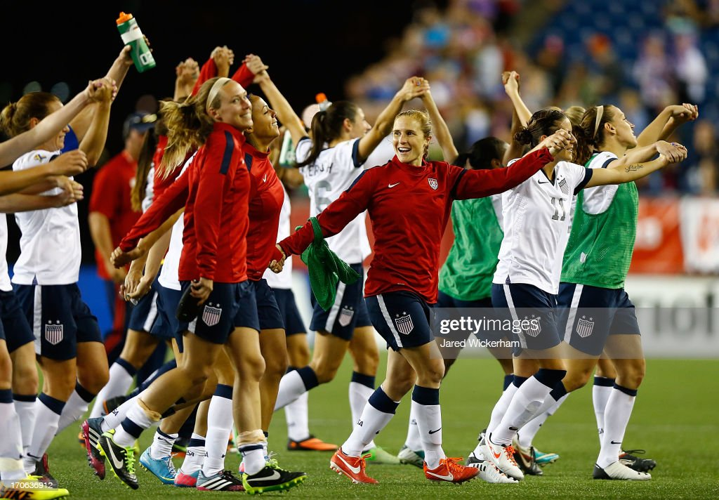 Members of the US Womens National team thank the crowd in attendance following their 4-1 win against Korea Republic during the game at Gillette Stadium on June 15, 2013 in Foxboro, Massachusetts.