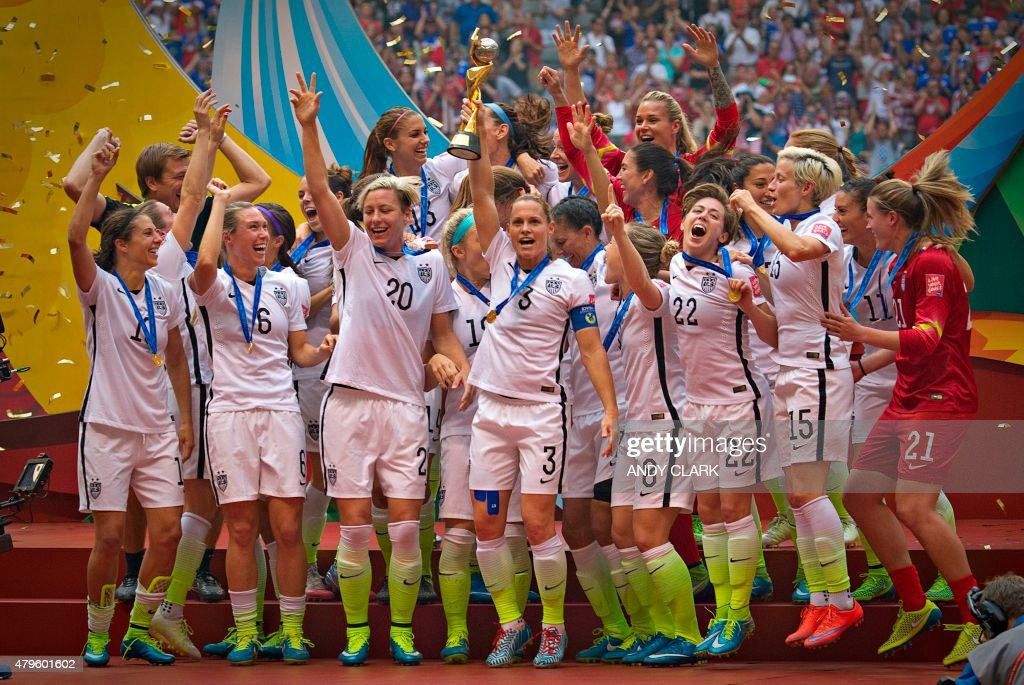 Members of the USA celebrate winning the the championship football match against Japan at during the 2015 FIFA Women's World Cup in Vancouver on July...