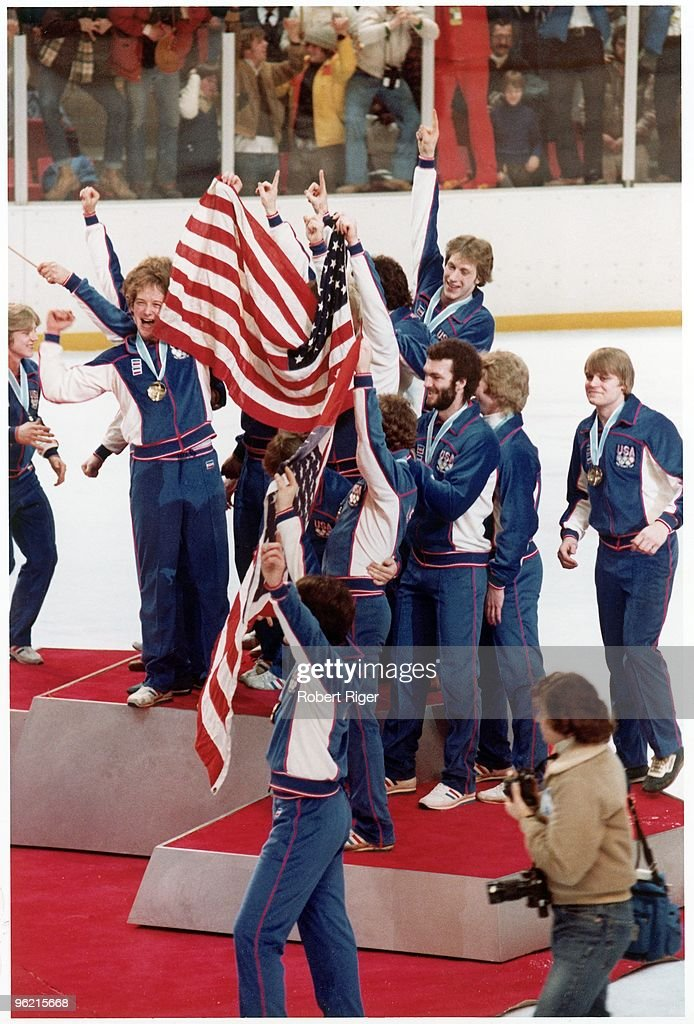 Members of the USA hockey team celebrate after winning the Gold Medal during the 1980 Winter Olympics on February 24 1980 in Lake Placid New York