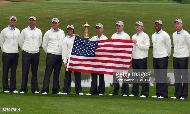 Members of the USA team pose with the American flag and the Ryder Cup Trophy Dustin Johnson Stewart Cink Jeff Overton Rickie Fowler Corey Pavin Zach...