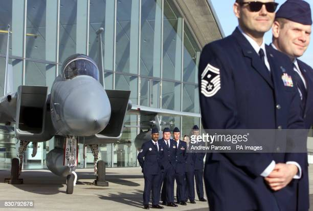 Members of the USAF 48th Fighter Wing from RAF Lakenheath in Suffolk stand in front of the F15a Eagle jet fighter which they volunteered to restore...