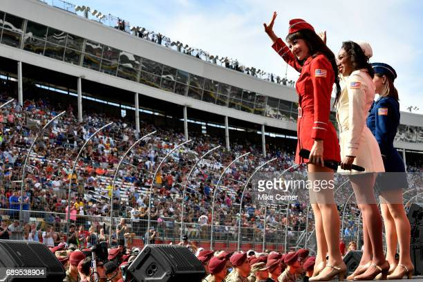 Members of the USO wave to the crowd prior to the start of the Monster Energy NASCAR Cup Series CocaCola 600 at Charlotte Motor Speedway on May 28...