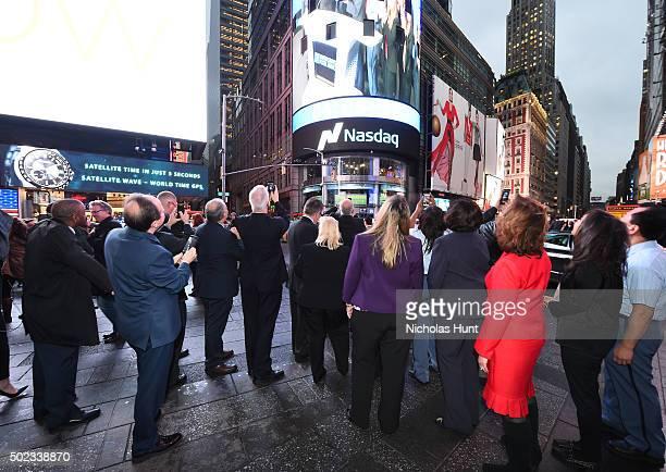 Members of the 'USPS' attend United States Postal Service's Operation Santa To Ring The Nasdaq Stock Market Closing Bell at NASDAQ MarketSite on...