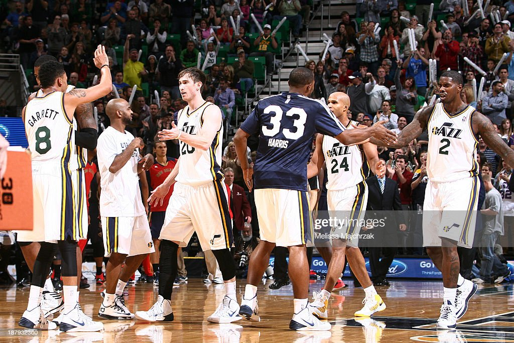 Members of the Utah Jazz respond during their victory over the New Orleans Pelicans at EnergySolutions Arena on November 13, 2013 in Salt Lake City, Utah.