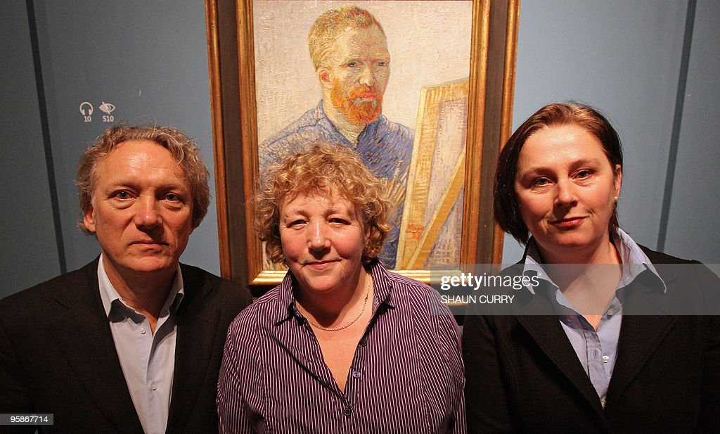 Members of the Van Gogh family pose for photographs alongside a self portrait of Dutch artist Vincent Van Gogh at the opening of an exhibition of the artists paintings and letters entitled 'The Real Van Gogh' at the Royal Academy of Arts in central London, on January 19, 2010. The family members are (From L-R) Willem Van Gogh, Silvia Cramer and Josien Cramer. The exhibition runs from January 23, to April 18, 2010, and is the first major exhibtion of his works to be displayed in London for over 40 years. AFP PHOTO/Shaun Curry