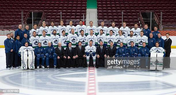Members of the Vancouver Canucks pose for their official team photo at Rogers Arena on April 4 2014 in Vancouver British Columbia Canada Front Row...