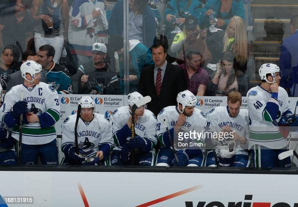 Members of the Vancouver Canucks sit on the bench during a game against the San Jose Sharks in Game One of the Western Conference Quarterfinals...