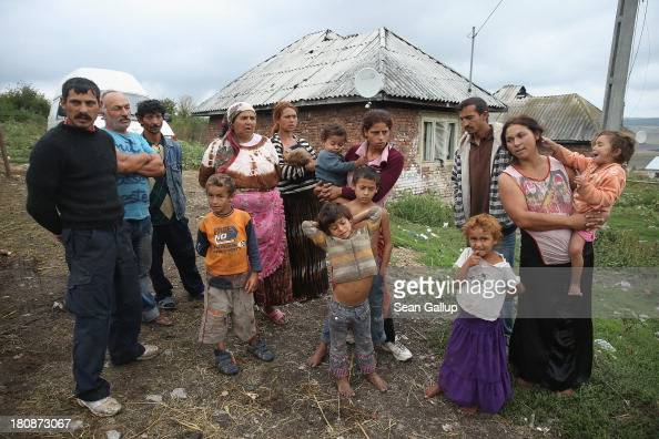 Members of the Varga family who spent a year in France before taking money from the French government to leave gather near their home in the abjectly...