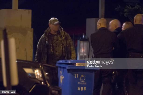 Members of the Victoria Police Special Operations Group are seen during a siege with an armed gunman in the Melbourne suburb of Brighton on June 5...