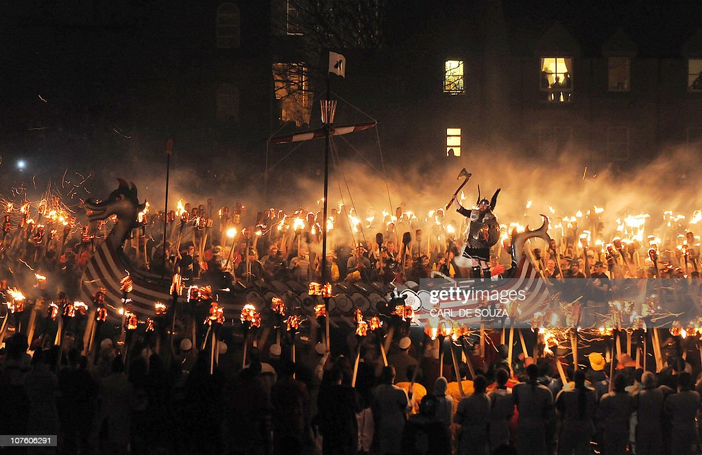 Members of the Viking Jarl Squad surround their leader or 'Guizer Jarl' on a Viking galley ship during the annual Up Helly Aa Festival Lerwick...