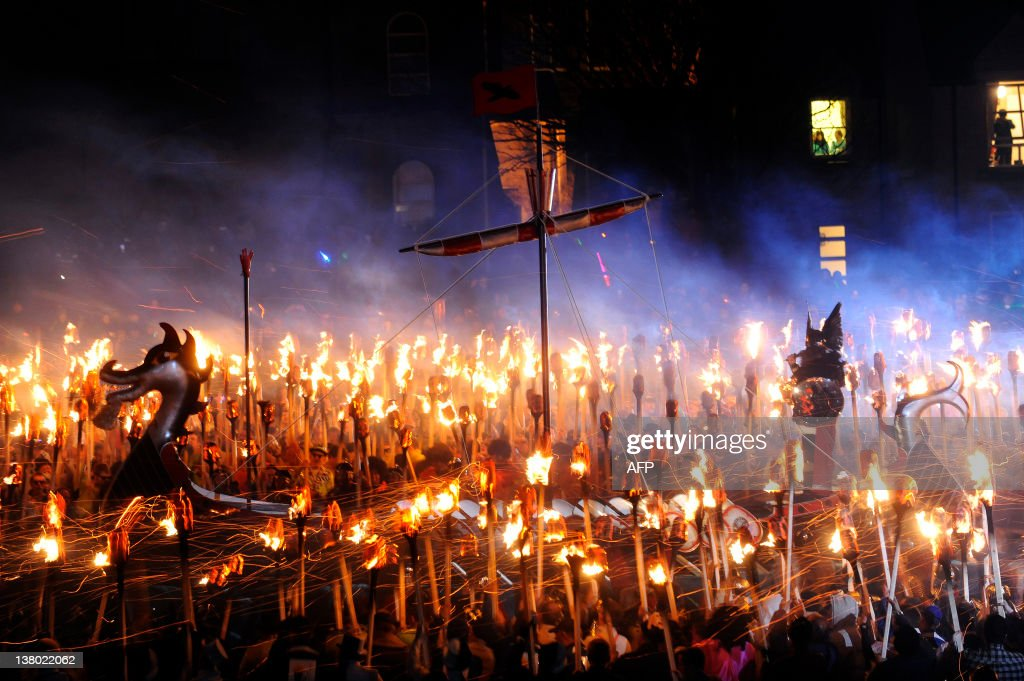 Members of the Viking Jarl Squad surround their leader or 'Guizer Jarl' on a Viking galley ship during the annual Up Helly Aa Festival in the...