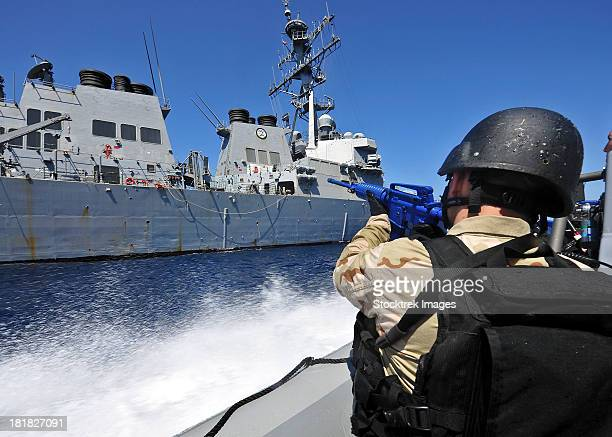 Members of the visit, board, search and seizure team alongside USS Porter.