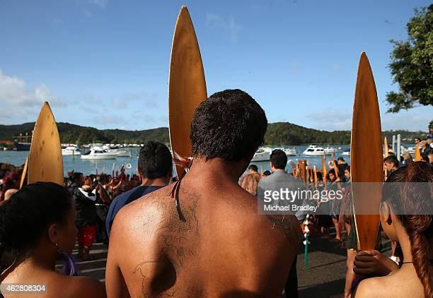 Members of the Waka wait to board their waka to head to Te Tii Waitangi Marae on February 6 2014 in Paihia New Zealand The Waitangi Day national...