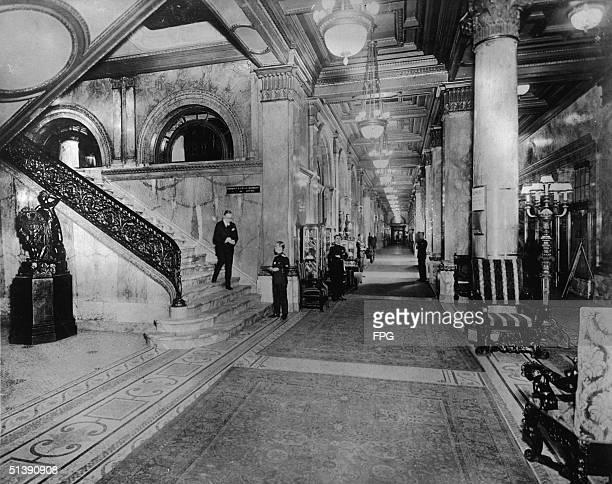 Members of the WaldorfAstoria hotel staff stand in Peacock Alley awaiting guests New York New York 1910s Peacock Alley was a three hundred foot long...