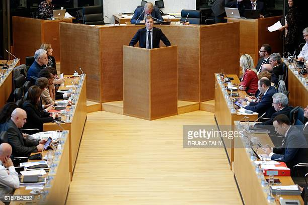Members of the Wallon parliament listen as Walloon MinisterPresident Paul Magnette speaks at a plenary session during a debate on the CETA on October...