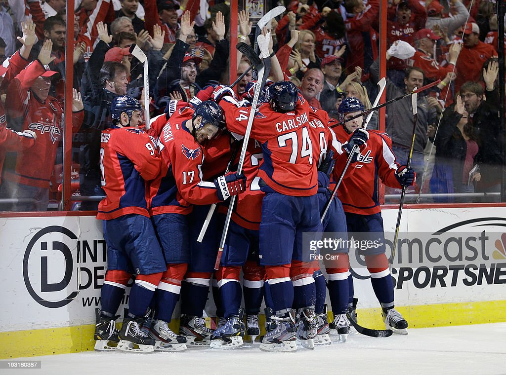 Members of the Washington Capitals celebrate after defeating the Boston Bruins 4-3 in overtime at Verizon Center on March 5, 2013 in Washington, DC.