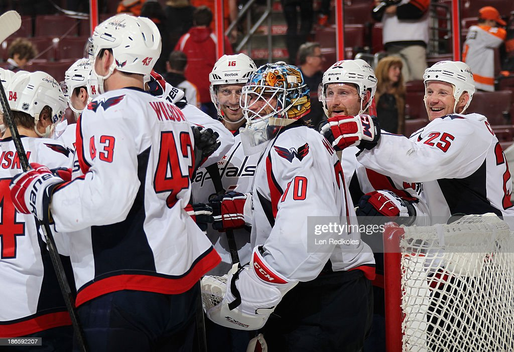 Members of the Washington Capitals celebrate around goaltender <a gi-track='captionPersonalityLinkClicked' href=/galleries/search?phrase=Braden+Holtby&family=editorial&specificpeople=5370964 ng-click='$event.stopPropagation()'>Braden Holtby</a> #70 after defeating the Philadelphia Flyers 7-0 on November 1, 2013 at the Wells Fargo Center in Philadelphia, Pennsylvania.