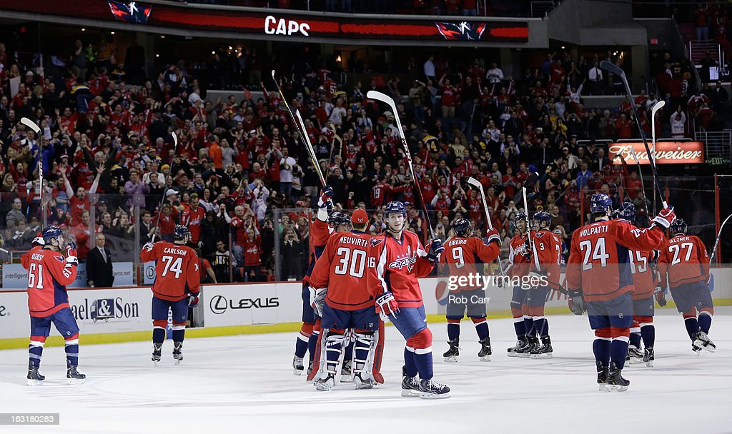 Members of the Washington Capitals celebrate on the ice after defeating the Boston Bruins 4-3 in overtime at Verizon Center on March 5, 2013 in Washington, DC.