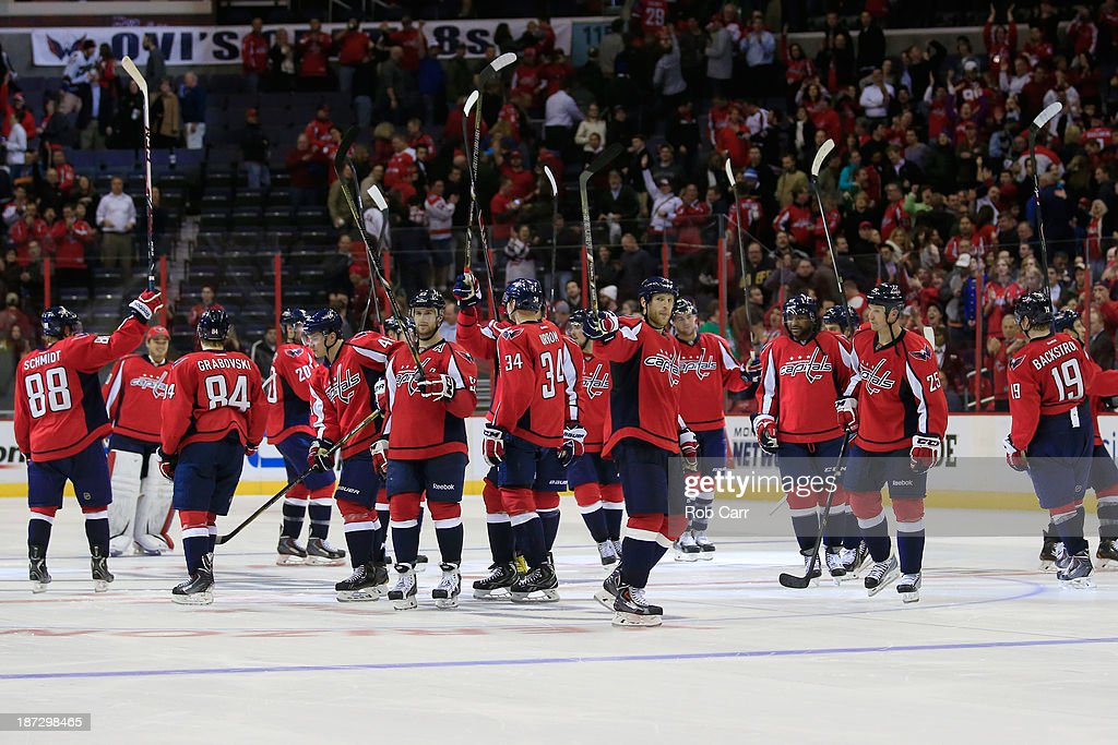 Members of the Washington Capitals celebrate on the ice after defeating the Minnesota Wild 3-2 in a shootout at Verizon Center on November 7, 2013 in Washington, DC.