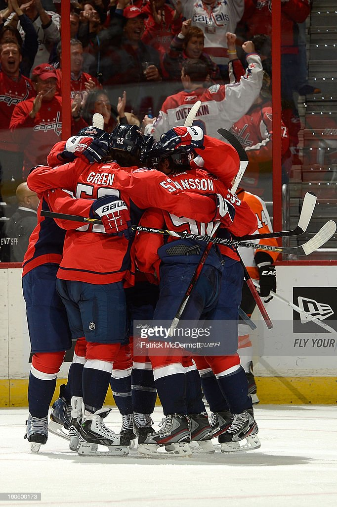 Members of the Washington Capitals congratulate <a gi-track='captionPersonalityLinkClicked' href=/galleries/search?phrase=Troy+Brouwer&family=editorial&specificpeople=4155305 ng-click='$event.stopPropagation()'>Troy Brouwer</a> #20 after his goal in the second period of an NHL hockey game against the Philadelphia Flyers at Verizon Center on February 1, 2013 in Washington, DC.