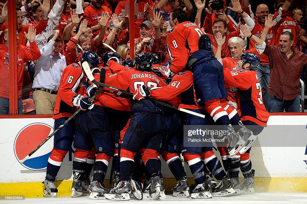 Members of the Washington Capitals mob <a gi-track='captionPersonalityLinkClicked' href=/galleries/search?phrase=Mike+Ribeiro&family=editorial&specificpeople=203275 ng-click='$event.stopPropagation()'>Mike Ribeiro</a> #9 following his overtime game winning goal in Game Five of the Eastern Conference Quarterfinals during the 2013 NHL Stanley Cup Playoffs between the New York Rangers and Washington Capitals at Verizon Center on May 10, 2013 in Washington, DC. The Capitals defeated the Rangers 2-1