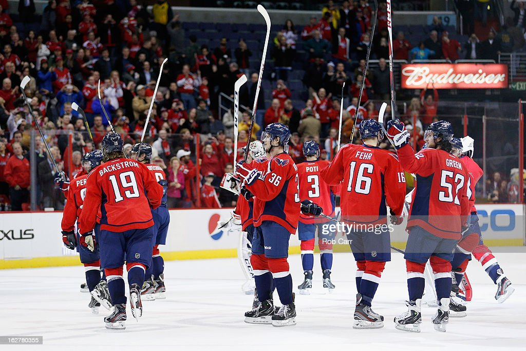 Members of the Washington Capitals salute the crowd after defeating the Carolina Hurricanes 3-0 at Verizon Center on February 26, 2013 in Washington, DC.