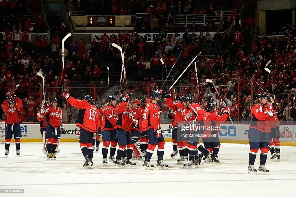 Members of the Washington Capitals salute the fans following their 5-0 victory over the Florida Panthers at Verizon Center on February 9, 2013 in Washington, DC.