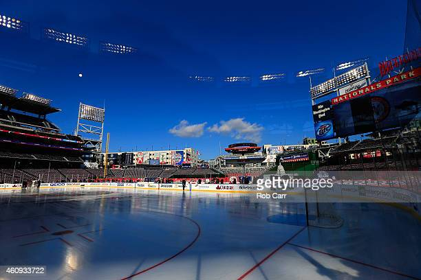 Members of the Washington Capitals skate on the ice during practice for the 2015 NHL Winter Classic against the Chicago Blackhawks at Nationals Park...