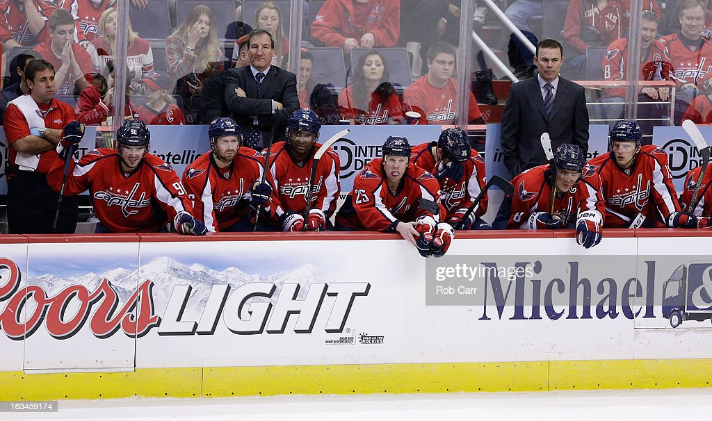 Members of the Washington Capitals watch the third period against the New York Rangers from the bench at Verizon Center on March 10, 2013 in Washington, DC.