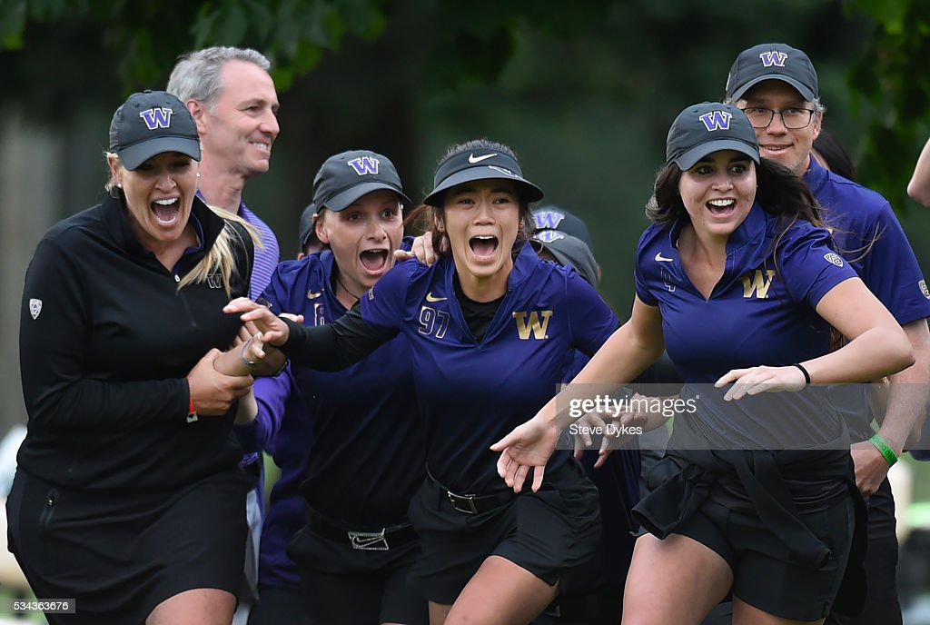 Members of the Washington Huskies golf team celebrate as they run onto the green after winning the 2016 NCAA Division I Women's Golf Championship...