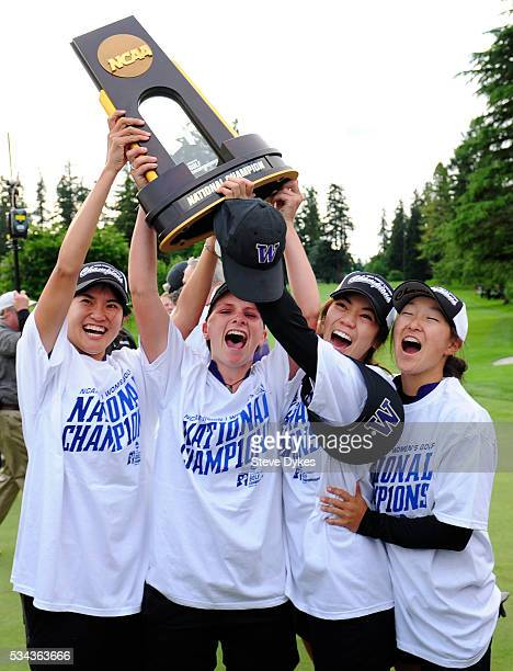 Members of the Washington Huskies golf team hoist the trophy after winning the 2016 NCAA Division I Women's Golf Championship against Stanford at...