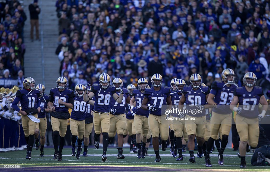 Members of the Washington Huskies take the field before a football game against the Washington State Cougars at Husky Stadium on November 27, 2015 in Seattle, Washington. The Huskies won the game 45-10.