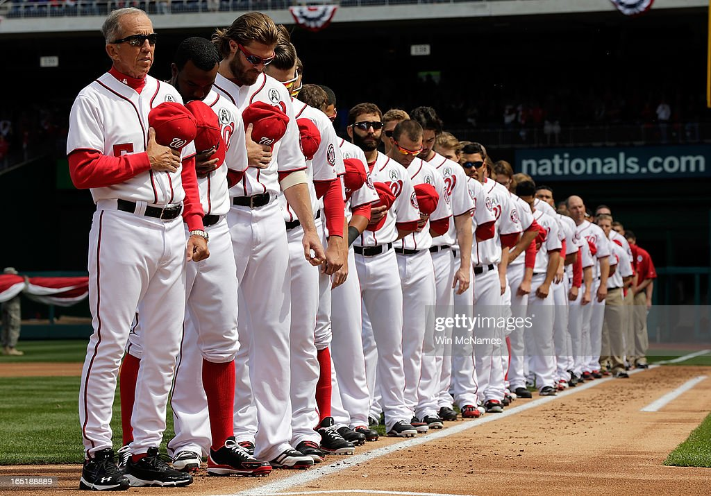 Members of the Washington Nationals bow their heads in a moment of silence for victims of the attack at Sandy Hook Elementary School before the Opening Day game against the Miami Marlins at Nationals Park on Monday, April 1, 2013 in Washington, DC.