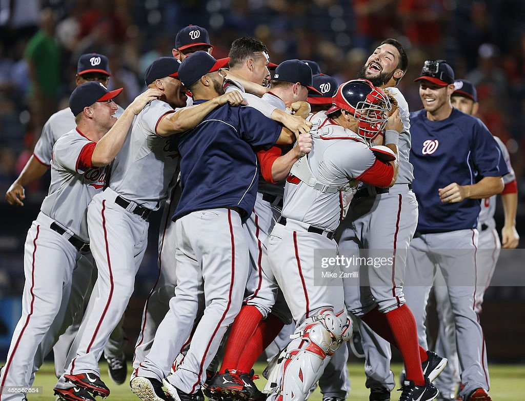 Members of the Washington Nationals celebrate after the divisionclinching game against the Atlanta Braves at Turner Field on September 16 2014 in...