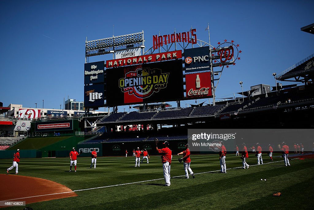 Members of the Washington Nationals warm up in the oufield prior to their Opening Day start againt the New York Mets at Nationals Park on April 6, 2015 in Washington, DC.