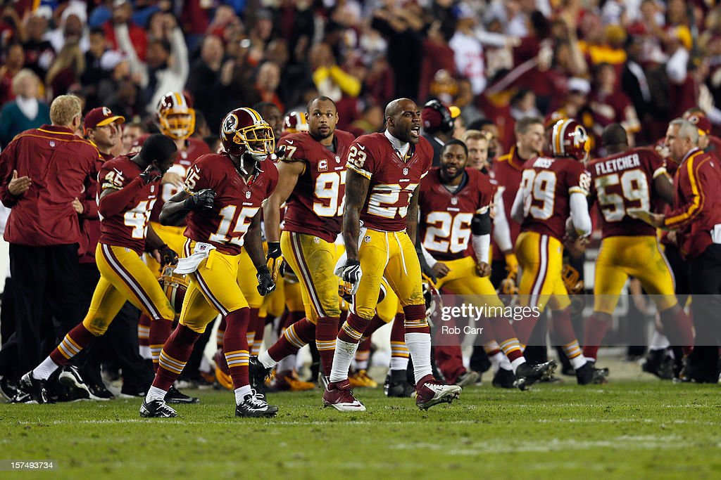 Members of the Washington Redskins celebrate after defeating the New York Giants 17-16 at FedExField on December 3, 2012 in Landover, Maryland.