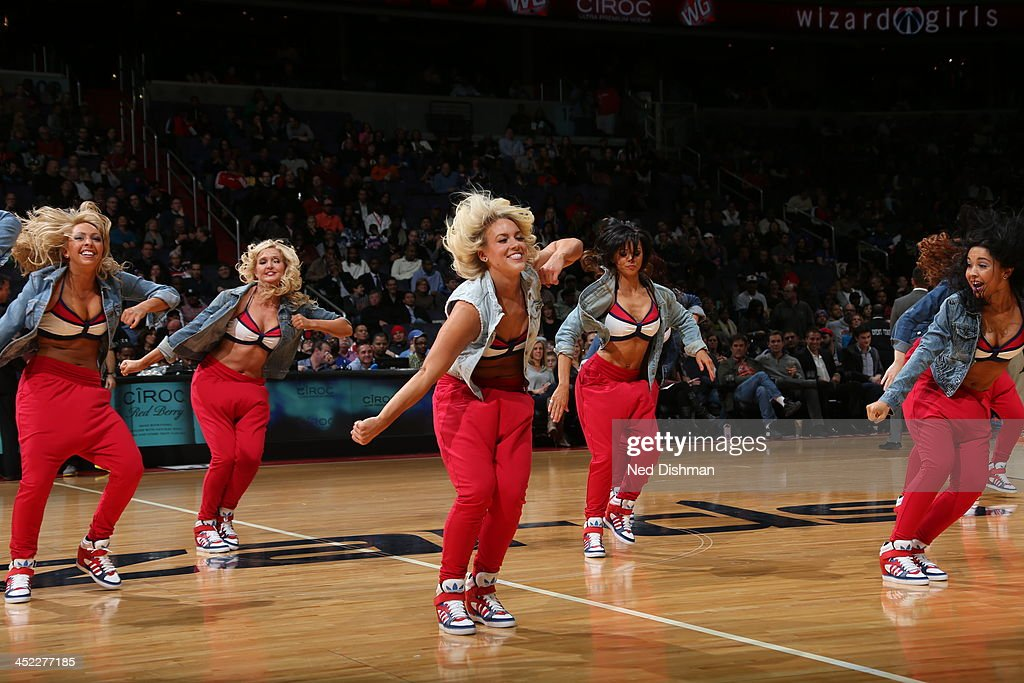 Members of the Washington Wizards dance team perform for the crowd against the New York Knicks during the game at the Verizon Center on November 23, 2013 in Washington, DC.