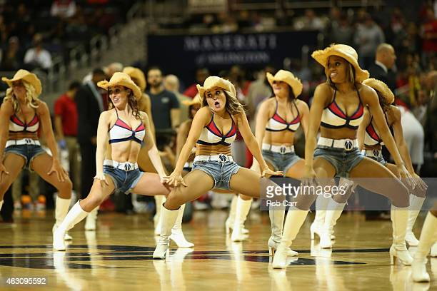Members of the Washington Wizards Girls perform during the first half of the Wizards and Orlando Magic game at Verizon Center on February 9 2015 in...