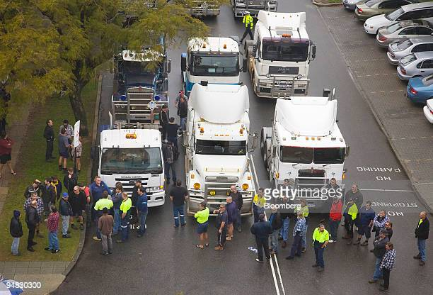 Members of the West Australian Long Distance Owners and Drivers Association protest near Parliament House with a convoy of trucks in Perth Australia...