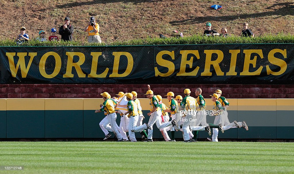 Members of the West team from Huntington Beach, California take a victory lap in the outfield after defeating the Japan team from Hamamatsu City, Japan 2-1 to win the Little League Word Series championship game on August 28, 2011 in South Williamsport, Pennsylvania.