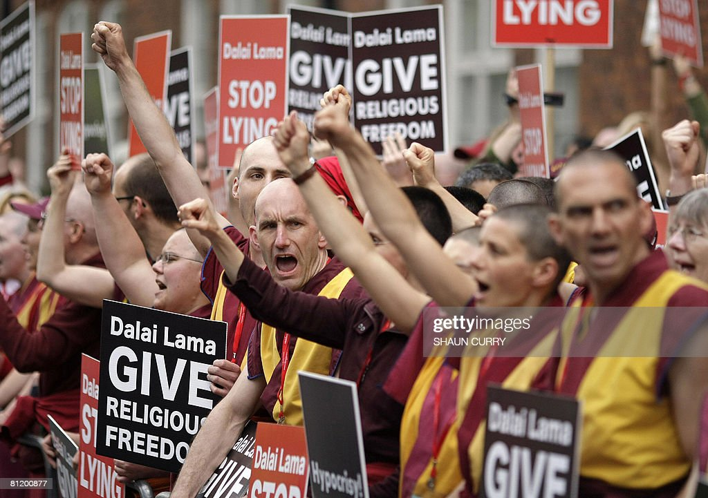 Members of the Western Shugden Society protest as the Dalai Lama arrives at the Royal Albert Hall in London, on May 22, 2008. China's response to the earthquake disaster shows encouraging signs of openness, but Beijing still lacks the moral authority of a true superpower, the Dalai Lama said Thursday. Speaking on the third day of a visit to Britain, Tibet's spiritual leader -- who faced protests during the day -- warned that China's 'ruthless suppression' in Tibet would only fan calls for independence, which he did not back. AFP PHOTO/Shaun Curry