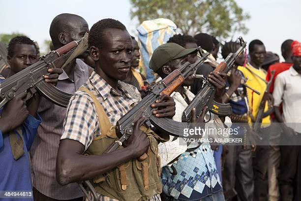 Members of the White Army a South Sudanese antigovernment militia attend a rally in Nasir on April 14 2014 Conflict in South Sudan has triggered a...