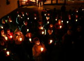 Members of the WhitmanWalker Clinic community hold a candlelight vigil outside the Bethlehem Baptist Church to mark World AIDS Day December 1 2008 in...