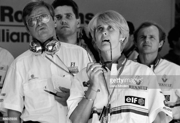 Members of the Williams team watch a replay of race car driver Ayrton Senna's accident during the San Marino Grand Prix on the Imola Circuit Imola...