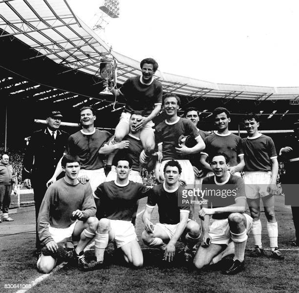Members of the Wimbledon team with their captain Roy Law who proudly holds aloft the FA Amateur Cup after they beat Sutton United 42 during the final...